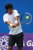 Sea games: tennis. Indonesia tennis player, Christopher rungkat, trying to hit the ball in a match in 26th Southeast Asian Games in Palembang, Indonesia Stock Image