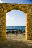 Sea gate. Stone gate with sea view at Cefalu Sicily promenade stock image