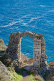 Sea_gate. A stone ruin gate near the sea Stock Photos