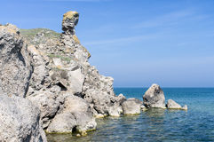 The sea and  a girl. The sea and the rock in the form of a girl Stock Images