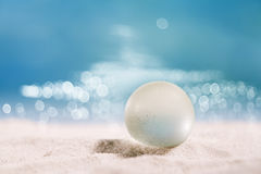Sea glass ball seaglass on  sand with ocean , beach and patches Royalty Free Stock Photos