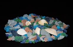 Sea glass. A colorful pile of sea glass with seashells Royalty Free Stock Photography