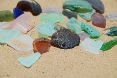 Sea Glass. Colorful sea glass on sandy beach on the US Virgin Island of St. Croix Royalty Free Stock Photography