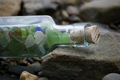 Sea Glass In A Corked Bottle Royalty Free Stock Photography