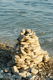 Sea glass pebbles are stacked on top of each other. A pyramid  stones. Sea glass pebbles are stacked on top of each other. A pyramid of stones. Sea Royalty Free Stock Photo