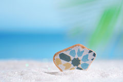 Sea glass seaglass on glitter sand with ocean Royalty Free Stock Photography