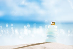 Sea glass seaglass with golden crown Stock Image