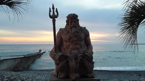 Sea god Neptune at sunset, Sochi resort. Sea god Neptune on the the seaside promenade in Sochi. Sunset at the Black Sea, travel Russia Stock Photo