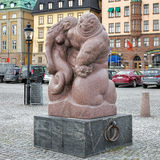 Sea God sculpture on the Skeppsbrokajen quay of Stockholm, Sweden Stock Photography