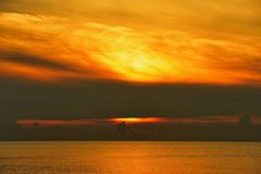 Sea and gold sky Sunrise royalty free stock image