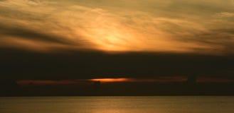 Sea and gold sky Sunrise royalty free stock photos