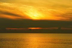 Sea and gold sky Sunrise stock images