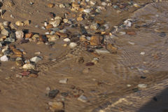 Sea gravel. Detail view of gravel in the sea stock photos