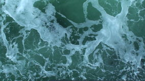 Sea green water with white waves. Video of sea green water with white waves stock footage