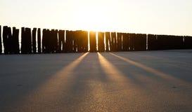 Sea groynes at sunset 2 Royalty Free Stock Image