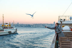 Sea Gull flying following passenger Vessel and Woman Stock Images