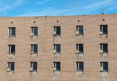 Sea gulls nesting on window sills of the abandoned building in the Russian ghost town Pyramiden in Svalbard archipelago. In the High Arctic Royalty Free Stock Photo