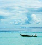Sea gypsies children kayaking Stock Photography