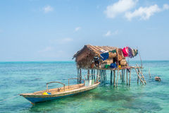Sea Gypsy house on stilts in the middle of the sea Royalty Free Stock Photo