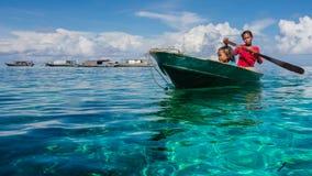 Sea Gypsy Kids on their Sampan Stock Photos