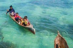 Sea Gypsy Kids on their sampan Royalty Free Stock Photo