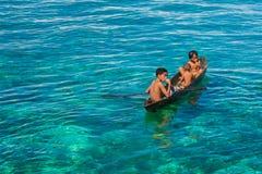 Sea Gypsy Kids on their Sampan Stock Photo