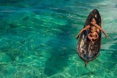 Sea Gypsy Kids on their Sampan Royalty Free Stock Image