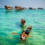 Sea Gypsy Kids on their sampan at their house on stilts Royalty Free Stock Photo
