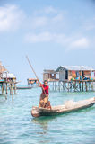 Sea Gypsy Woman paddling her sampan with her kids Stock Images
