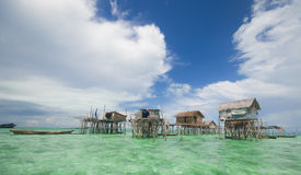 Sea gysies houses on stilts Stock Image