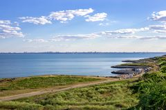 Sea harbor with blue water and blue sky with clouds Stock Photos