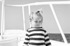 Sea is his vocation. Baby boy enjoy vacation cruise ship. Child cute sailor yacht sunny day. Boy adorable sailor striped. Shirt white yacht travel around world stock images