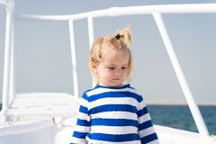 Sea is his vocation. Baby boy enjoy vacation cruise ship. Child cute sailor yacht sunny day. Boy adorable sailor striped Stock Images