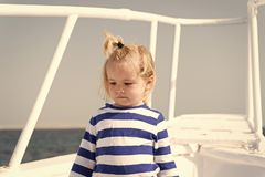 Sea is his vocation. Baby boy enjoy vacation cruise ship. Child cute sailor yacht sunny day. Boy adorable sailor striped. Shirt white yacht travel around world stock photography