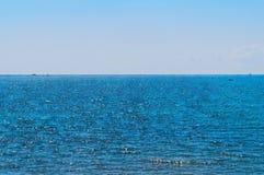 Sea horison. Bright water and shiny sky Royalty Free Stock Photos
