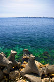 Sea horizon. With breakwaters for shore protection Royalty Free Stock Photos