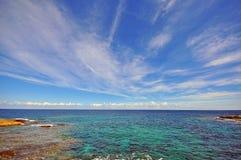 Sea, horizon and blue sky Royalty Free Stock Photo