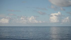 Sea horizon with clouds. Clean background. Sea, ocean. Travel background. Light blue backgrounda and water surface background. stock video footage