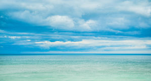 Sea, horizon and clouds in the sky Stock Photo