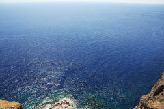 Sea horizon with rocks Stock Photography