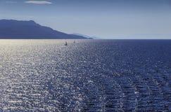 Sea horizon with sailboats in the sunshine. Sailboats in the sunshine: coast of Greece in the Aegean Sea royalty free stock photos