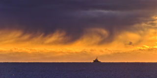 Sea Horizon Sun ship Stock Photo