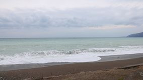 Sea horizon view from shore pan left. stock footage