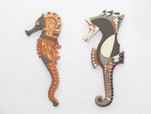 Sea horses. Two original sea horses manufactured with clay. Pieces of craftwork Royalty Free Stock Image
