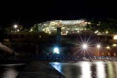 Sea hotel beach at night royalty free stock photography