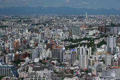 Sea of houses. Tokyo cityscape with mountains in the background Stock Photos