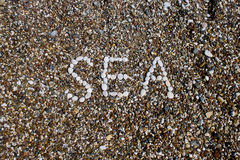 Sea inscription on a beach Royalty Free Stock Images