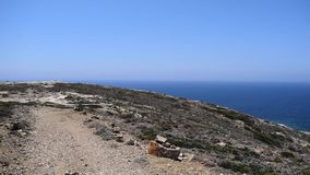 Sea and island. Sea around the island. Trail on the island of Rhodes in Prasonisi stock video