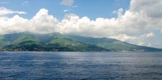 Sea island in the clouds. In Corsica Stock Photo