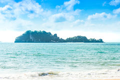 Sea island, sandy beaches, ocean waves, azure skies, and white c Royalty Free Stock Images